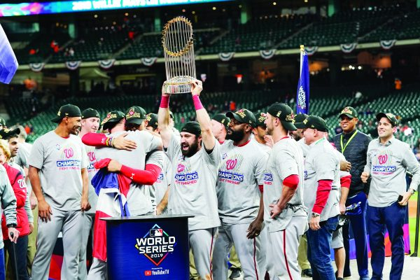 The Washington Nationals celebrate with the trophy after Game 7 of the baseball World Series against the Houston Astros Wednesday, Oct. 30, 2019, in Houston. The Nationals won 6-2 to win the series. (AP Photo/David J. Phillip)