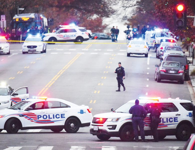Police secure the scene near Comet Ping Pong in Washington, Sunday, Dec. 4, 2016. A man who said he was investigating a conspiracy theory about Hillary Clinton running a child sex ring out of the pizza place fired an assault rifle inside the restaurant on Sunday injuring no one, police and news reports said. (Photo by Sarah L. Voisin/The Washington Post via AP)