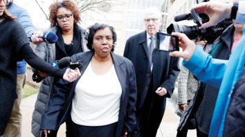 Tawanna Gaines, center, a former Maryland delegate, is swarmed by reporters while leaving the U.S. District Court in Greenbelt, Md., after her sentencing hearing, Friday, Jan. 3, 2020, in Greenbelt. Gaines was sentenced to six months in prison followed by two months of home detention for misusing campaign funds for her personal benefit. U.S. District Judge Theodore Chuang also on Friday ordered Gaines to pay $22,565 in restitution. (AP Photo/Julio Cortez)