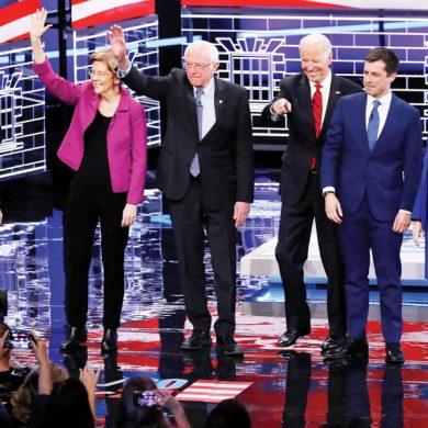 From left, Democratic presidential candidates, former New York City Mayor Michael Bloomberg, Sen. Elizabeth Warren, D-Mass., Sen. Bernie Sanders, I-Vt.,former Vice President Joe Biden, former South Bend Mayor Pete Buttigieg, Sen. Amy Klobuchar, D-Minn., stand on stage before a Democratic presidential primary debate Wednesday, Feb. 19, 2020, in Las Vegas, hosted by NBC News and MSNBC. (AP Photo/John Locher)