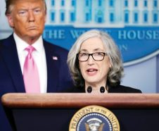 President Donald Trump listens as Anne Schuchat, principal deputy director of the Centers for Disease Control and Prevention, speaks during a news conference about the coronavirus in the Brady Press Briefing Room of the White House, Wednesday, Feb. 26, 2020, in Washington. (AP Photo/Evan Vucci)