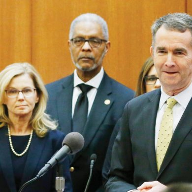 Gov. Ralph Northam, right, speaks during a news conference at the Capitol Wednesday March 11 , 2020, in Richmond, Va. Northam provided an update on the state's readiness to handle the coronavirus outbreak. (AP Photo/Steve Helber)