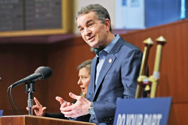 Virginia Gov. Ralph Northam gestures duding a news conference at the Capitol Monday May 4, 2020, in Richmond, Va. Northam announced a phase one opening of the state beginning May 15.(AP Photo/Steve Helber)