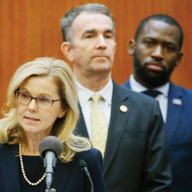 State Epidemiologist Dr. Lilian Peake, left, speaks as Virginia Gov. Ralph Northam, center and Richmond Mayor Levar Stoney, right, listen during a news conference at the Capitol Wednesday March 11 , 2020, in Richmond, Va. Northam and others provided an update on the states readiness to handle the Corona virus outbreak. (AP Photo/Steve Helber)