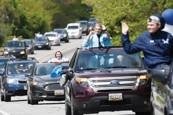 South River High School Class of 2020 senior Jocelyn Fillius, 18, of Churchtom, Md., second from right, along with other South River High School senior make their way down a road during a community-organized parade, Saturday, April 25, 2020. Many of the South River High School families found ways to celebrate their seniors given that prom, graduation and other traditional senior activities were canceled. Parades were organized, they lit up the night and decorated their homes as well as being adopted by strangers who brought them gifts. (AP Photo/Susan Walsh)