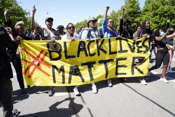 People gather for a Black Lives Matter demonstration in front of the US Embassy in Copenhagen, Denmark, Sunday, May 31, 2020. Protesters gathered in front of the embassy under the heading 'I Can't Breathe', to express their feelings in regard to the death of 46-year old George Floyd while in police custody in Minneapolis, USA. (Ida Guldbaek Arentsen/Ritzau scanpix via AP)