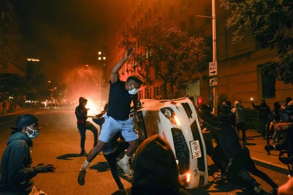Demonstrators vandalize a car as they protest the death of George Floyd, Sunday, May 31, 2020, near the White House in Washington. Floyd died after being restrained by Minneapolis police officers. (AP Photo/Evan Vucci)