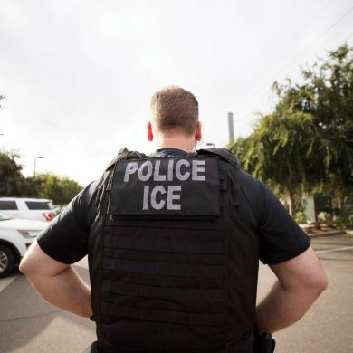 FILE - In this July 8, 2019, file photo, a U.S. Immigration and Customs Enforcement (ICE) officer looks on during an operation in Escondido, Calif. A sweeping expansion of deportation powers unveiled this week by the Trump administration has sent chills through immigrant communities and prompted some lawyers to advise migrants to gather up as much documentation as possible _ pay stubs, apartment leases or even gym key tags _ to prove they've been in the U.S.(AP Photo/Gregory Bull, File)