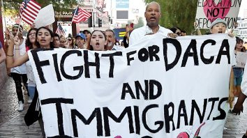 LAS VEGAS, NV - SEPTEMBER 10:  Nevada Senate Majority Leader Aaron D. Ford (D-Las Vegas) (3rd L) joins immigrants and supporters as they march on the Las Vegas Strip during a