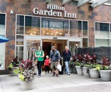 People walk out of the Hilton Garden Inn, in New York, Monday, May 18, 2015. New York City police are investigating the death of a man found unconscious, with a head injury, under a mattress at the hotel, blocks from the Empire State Building. (AP Photo/Richard Drew)