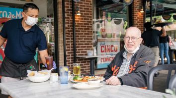Retiree Dave Hillyard enjoys outdoor dining at the Cactus Cantina in Washington, Friday, May 29, 2020, as the District of Columbia gradually loosens stay-at-home rules and restaurant restrictions that have been in place since March 25 because of the pandemic. (AP Photo/J. Scott Applewhite)