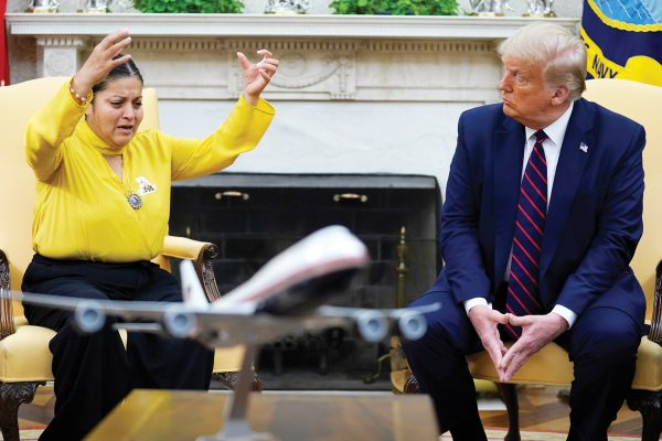 Army Spc. Vanessa Guillen's mother Gloria Guillen, left, speaks as she meets with President Donald Trump in the Oval Office of the White House on Thursday, July 30, 2020, in Washington. (AP Photo/Evan Vucci)