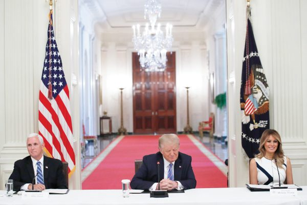 President Donald Trump, Vice President Mike Pence, left, and first lady Melania Trump, attend a
