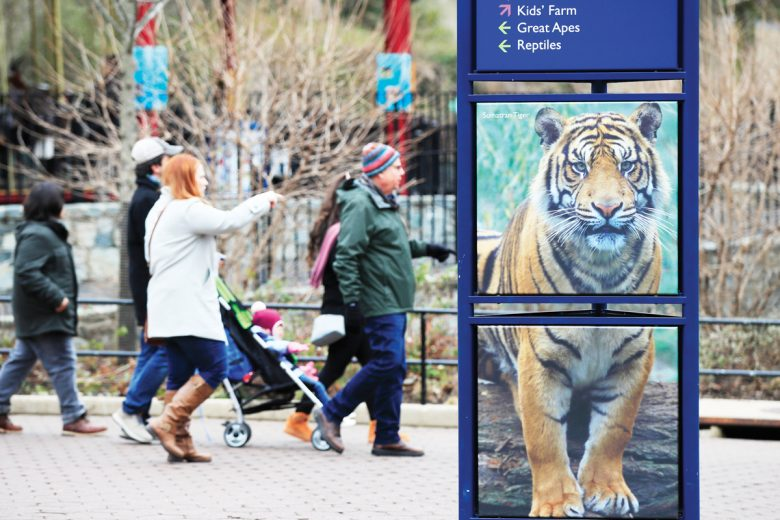 Visitors walk at the Smithsonian's National Zoo in Washington, Monday, Dec. 31, 2018. In the event of a prolonged government shutdown and the zoo closes, the zoo keepers will be working unpaid. (AP Photo/Manuel Balce Ceneta)
