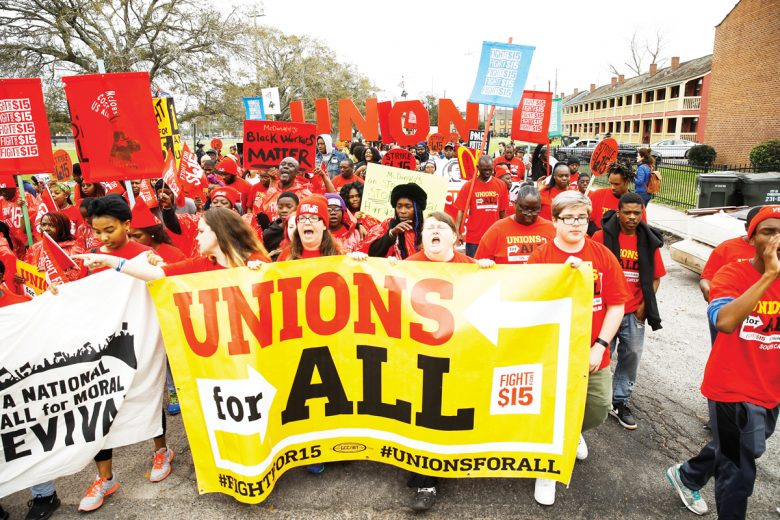 Democratic presidential candidate former South Bend, Ind., Mayor Pete Buttigieg marches with demonstrators calling for a union and $15 minimum wage at McDonald's, Monday, Feb. 24, 2020, in Charleston, S.C. (AP Photo/Matt Rourke)