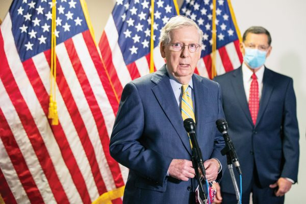 Senate Majority Leader Mitch McConnell, R-Ky., with Sen. John Barrasso, R-Wyo., speaks to reporters following a GOP policy meeting on Capitol Hill, Tuesday, June 30, 2020, in Washington. (AP Photo/Manuel Balce Ceneta)