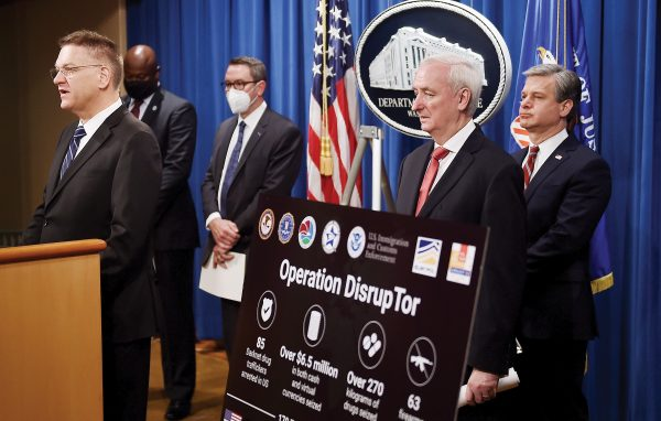 """From left, DEA Acting Administrator Timothy Shea, Chief Postal Inspector Gary Barksdale, ICE Acting Deputy Director Derek Benner, Deputy Attorney General Jeffrey Rosen, and FBI Director Christopher Wray, announce a worldwide crackdown on opioid trafficking on the darknet with FBI Director Christopher Wray, center, and DEA Acting Administrator Timothy Shea, during a press conference at the Department of Justice, Tuesday, Sept. 22, 2020 in Washington.  Law enforcement officials have arrested 179 people and seized more than $6.5 million. The operation announced Tuesday mainly occurred in the U.S. and in Europe. Rosen said the takedown showed """"there will be no safe haven for drug dealing in cyberspace."""" (Olivier Douliery/Pool via AP)"""
