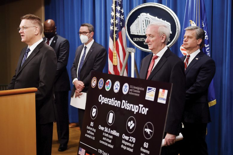 "From left, DEA Acting Administrator Timothy Shea, Chief Postal Inspector Gary Barksdale, ICE Acting Deputy Director Derek Benner, Deputy Attorney General Jeffrey Rosen, and FBI Director Christopher Wray, announce a worldwide crackdown on opioid trafficking on the darknet with FBI Director Christopher Wray, center, and DEA Acting Administrator Timothy Shea, during a press conference at the Department of Justice, Tuesday, Sept. 22, 2020 in Washington.  Law enforcement officials have arrested 179 people and seized more than $6.5 million. The operation announced Tuesday mainly occurred in the U.S. and in Europe. Rosen said the takedown showed ""there will be no safe haven for drug dealing in cyberspace."" (Olivier Douliery/Pool via AP)"