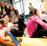 IMAGE DISTRIBUTED FOR SMITHSONIAN'S NATIONAL MUSEUM OF THE AMERICAN INDIAN - Fifth-grade students from New York City Public School 276 try out a kayak balancing activity at the imagiNATIONS Activity Center grand opening ceremony, Thursday, May 17, 2018 at the National Museum of the American Indian in New York. (Jason DeCrow/AP Images for Smithsonian's National Museum of the American Indian)
