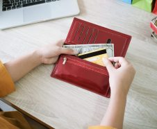 Female hand get money and  credit card from wallet